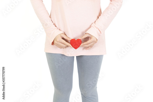 Obraz woman holding red heart put on the genitalia area, Penis pain or Itching urinary Health-care concept on white background - fototapety do salonu