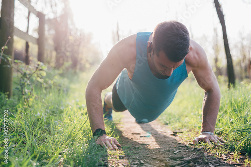 young man outdoor backlight training in the city Canvas Print
