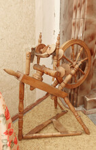 A Wooden Spinning Wheel For Em...