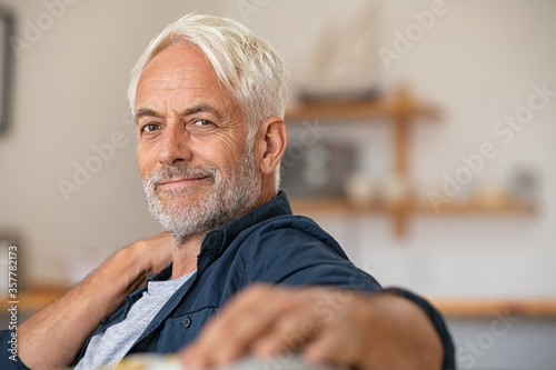Portrait of retired satisfied man at home Fototapeta