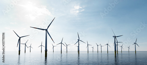 Tela Offshore wind turbines farm on the ocean. Sustainable energy