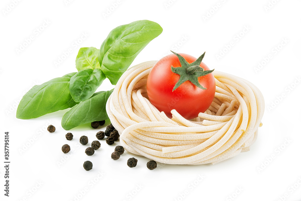 Pici, bronze-drawn durum wheat pasta, Tuscan handmade spaghetti, isolated on a white background with basil, peppercorns and cherry tomatoes.