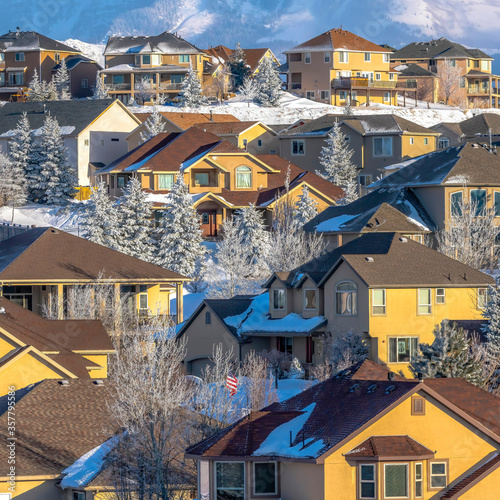 Square Homes of a mountainside residential community with views of Wasatch Mount Canvas Print