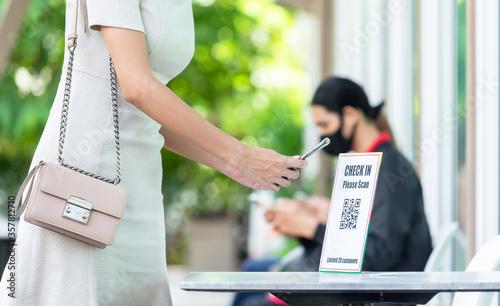 Fotografie, Obraz Woman use smartphone scan qr code for entering restaurant for application track