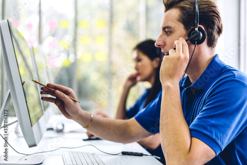 Obraz na plátně Group of happy call center smiling business operator customer support team phone