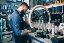 Young Beard Bicycle Mechanic R...
