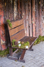 Decorated With Moss And Candles, The Location At The Wedding To Create An Atmosphere, A Wooden Bench Next To A Wooden Wall.