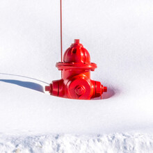 Square Red Fire Hydrant On A Snow Covered Mountain In Park City Utah In Winter