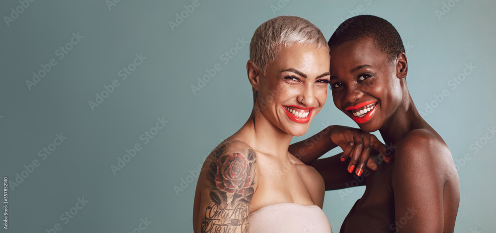 Fototapeta Two beautiful women with short hairstyle smiling together