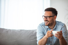 Cropped Portrait Of A Handsome Young Man Enjoying A Cup Of Coffee In The Morning. Portrait Of A Smiling Businessman Having A Break. Coffee First Then What To Do For The Day