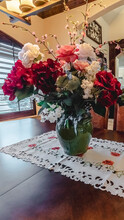 Vertical Frame Vase With Colorful Summer Flowers On Table