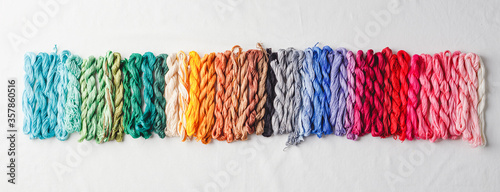 Fotomural Colorful pattern background from embroidery thread