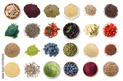 Photo Set of different superfoods on white background, top view