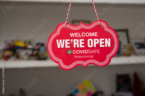 Fotografie, Obraz Welcome we are open sign in front of a shop after covid-19 pandemic