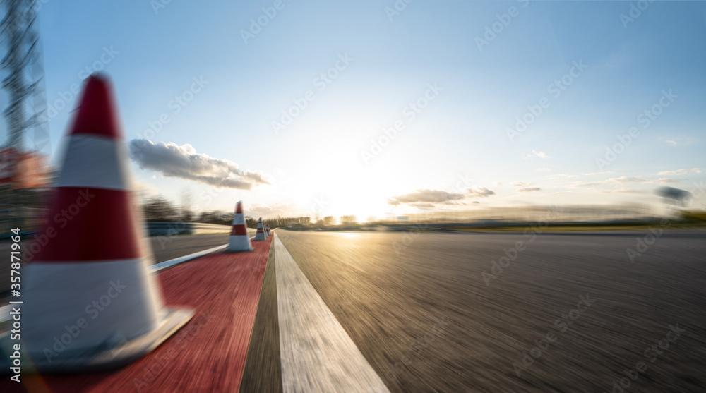 Fototapeta Race Car / motorcycle racetrack on a sunny day.