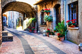 Fototapeta Uliczki - Charming old medieval villages of Italy with typical floral narrow streets. Assisi , Umbria