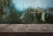 Wooden Table Near Window On Ra...