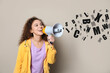 Leinwandbild Motiv Young African-American woman with megaphone and letters on light background. Speech therapy concept
