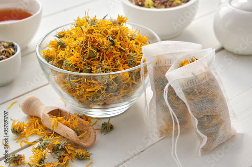 Bowl of dry marigold flowers, tea bags with dry Calendula plants Wallpaper Mural
