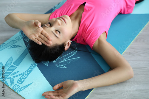Fototapeta A young woman was engaged in fitness at home background portrait