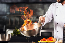 Chef Hands Keep Wok With Fire....