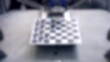 Blurred background. Robot play checkers close-up.
