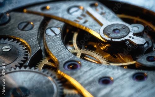 Fototapeta Clockwork gears wheels, close up view. Industry background. obraz