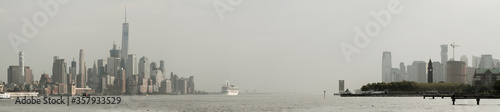 Panoramic view of foggy Manhattan and Jersey City skiline with white cruise liner passing by Wallpaper Mural