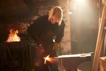 Female Blacksmith Forging Stee...