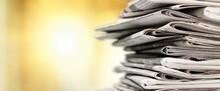 Pile Of Newspapers Stacks On B...