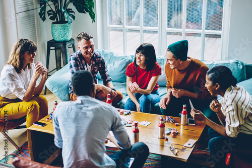 Obraz Friends spending free time together in flat - fototapety do salonu