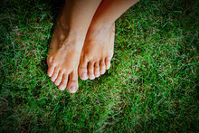 Feet On Grass Shot From Above....
