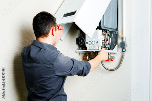 Leinwand Poster Repair of a gas boiler