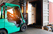 canvas print picture - Forklift loading shipment pallet goods into container shipping truck. Road freight cargo by truck transportation.