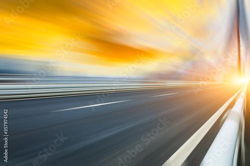 Leinwand Poster Fast moving asphalt road and bridge background.