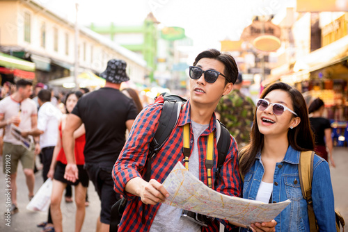 Asian couple tourists traveling at Khao San road Bangkok Thailand during summer Wallpaper Mural