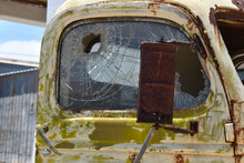 Old Rusty Car With Broken Window