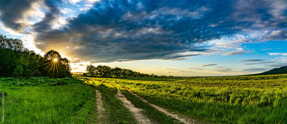 Fototapeta Country road at dawn far from civilization