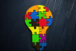 Diversity and creativity concept. Colored pieces of the puzzle in the shape of a bulb.