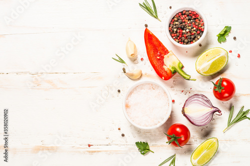 Fototapeta Food cooking background on white wooden table.