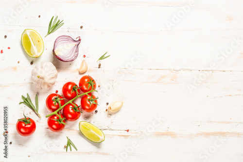Obraz na plátně Food cooking background on white wooden table.