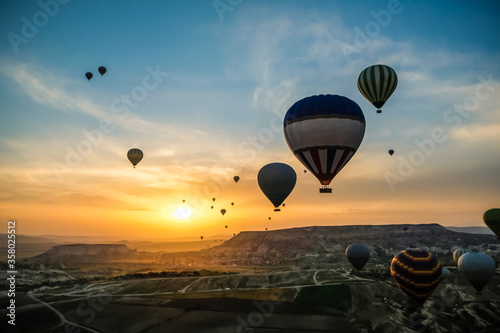 Aerial view of hot air balloons flying over spectacular at Cappadocia, Turkey Canvas Print