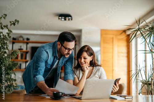 Fototapeta Couple doing finances at home, portrait. obraz