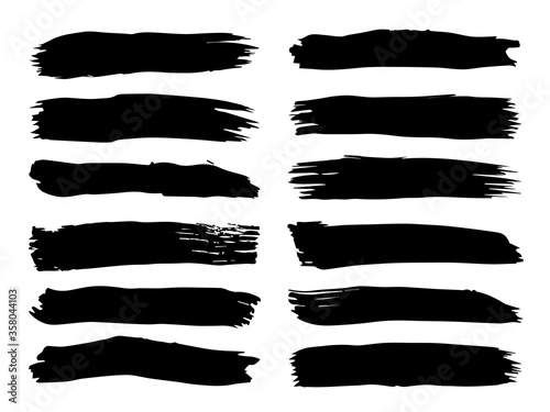 Fototapeta Collection of artistic grungy black paint hand made creative brush stroke set isolated on white background. A group of abstract grunge sketches for design education or graphic art decoration obraz