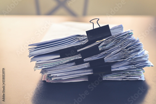 Vászonkép Close up document pile on office desk, stack of business paper on the table