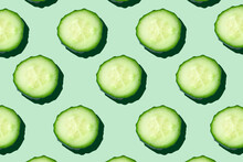 Regular Seamless Pattern Of Cucumber Slices On A  Pastel Mint Background.Photo Collage,hard Light, Shadow,pop Art Design. Food Blog, Vegetable Background. Printing On Fabric, Wrapping Paper.Top View.