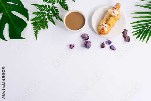 Top view of fresh bread and coffee,Fern leaf,monstera leaf, separate on a white background wood