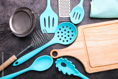 Set of different kitchen utensils and cutting board Wallpaper Mural