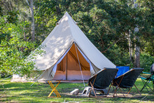 Glamping Camping Teepee Tent And Chairs At The Campsite