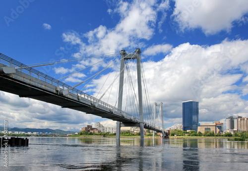Fototapeta Vynogradovskiy Bridge across the Yenisei river. Sunny noon on the island of Tytyshev. Krasnoyarsk obraz